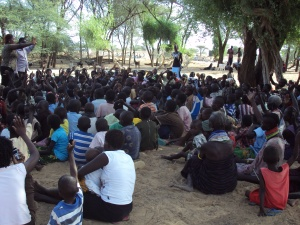 Missions of Hope Staff lead a parents meeting in Turkana, prior to the opening of the newest school: MoHi Lodwar.